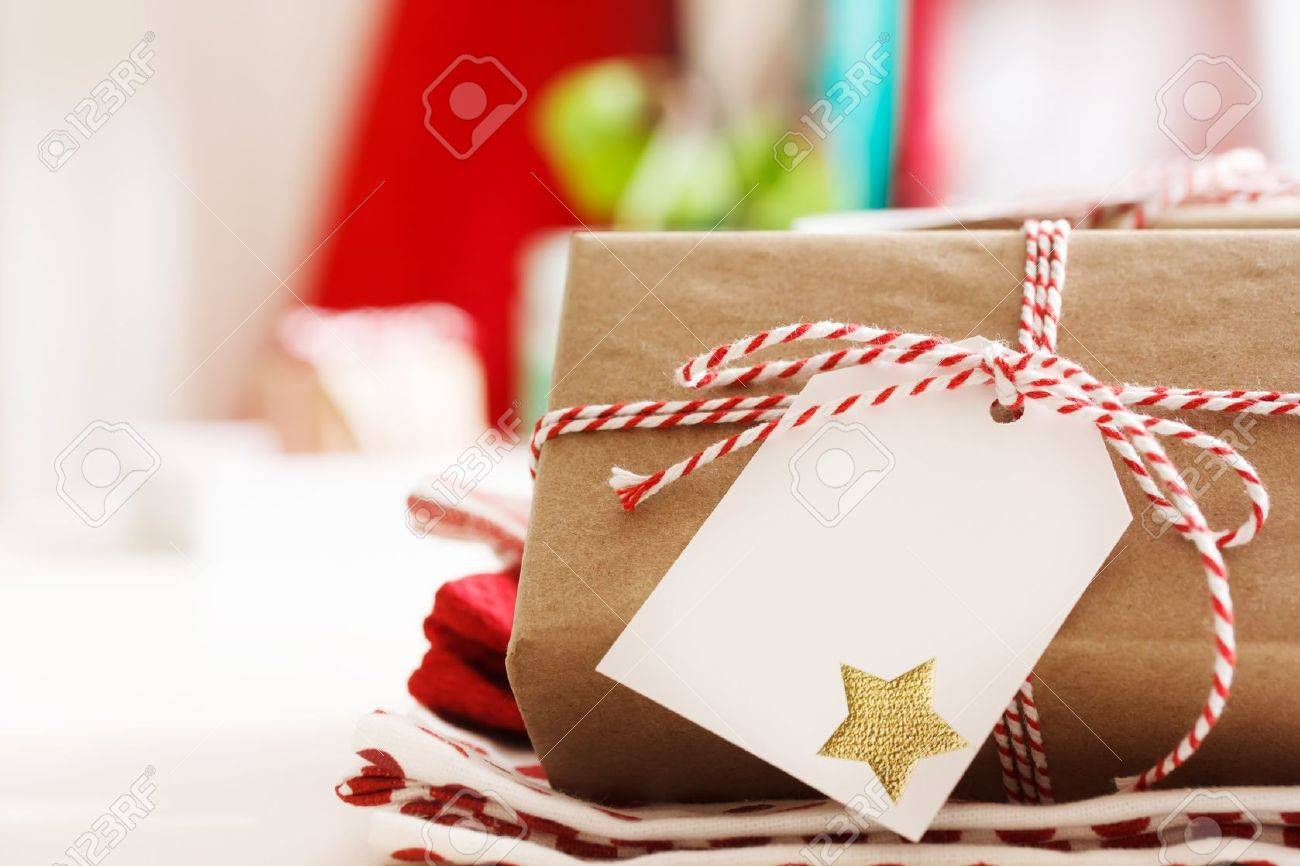 Handmade present boxes with tags and twine cord ribbons Stock Photo - 21689103