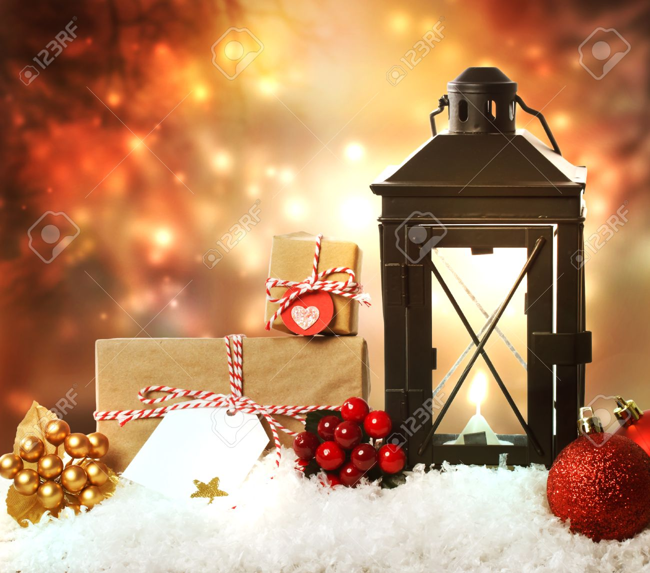Christmas Lantern With Presents, Ornaments And Snow Stock Photo ...
