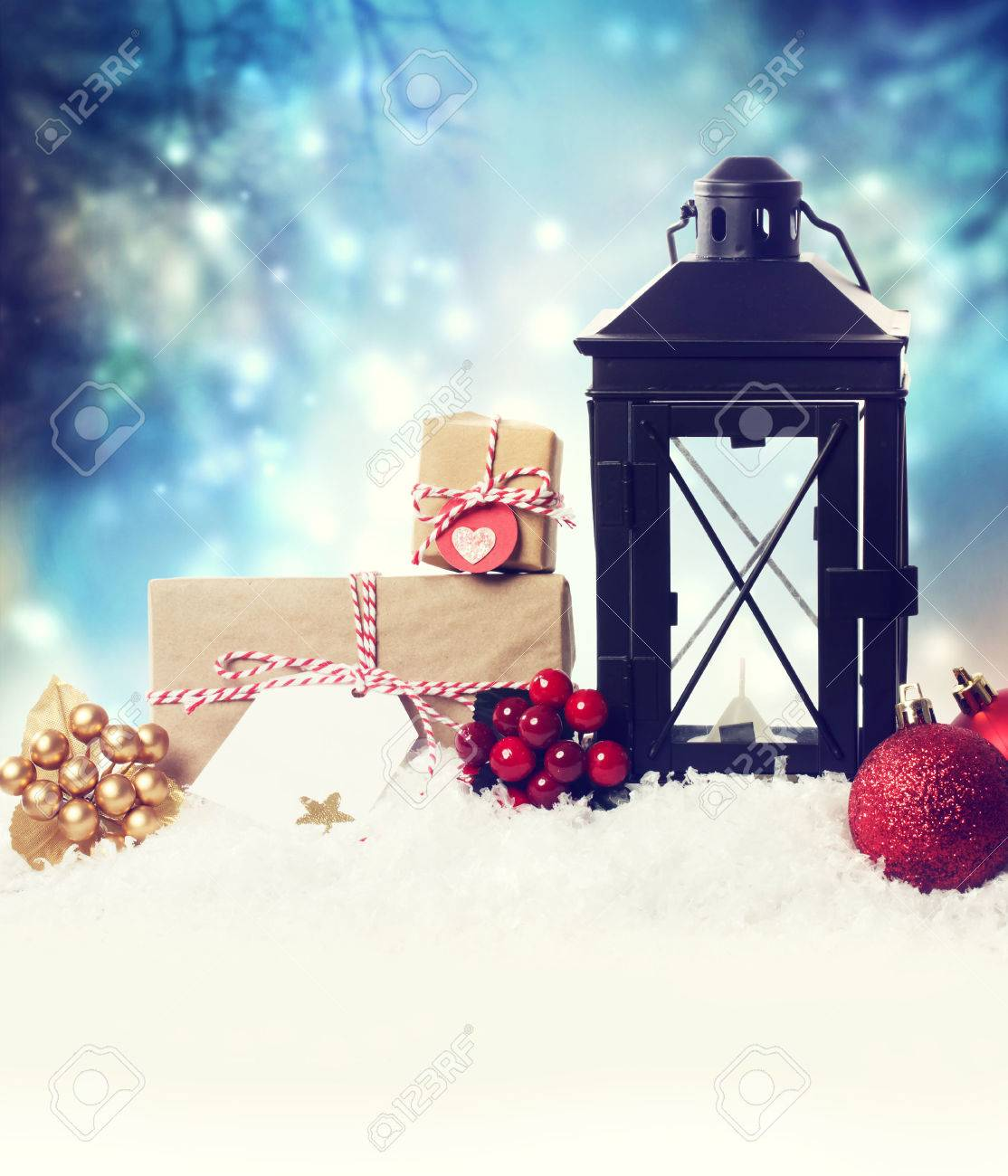 Christmas lantern with ornaments in the snow at night Stock Photo - 22876154