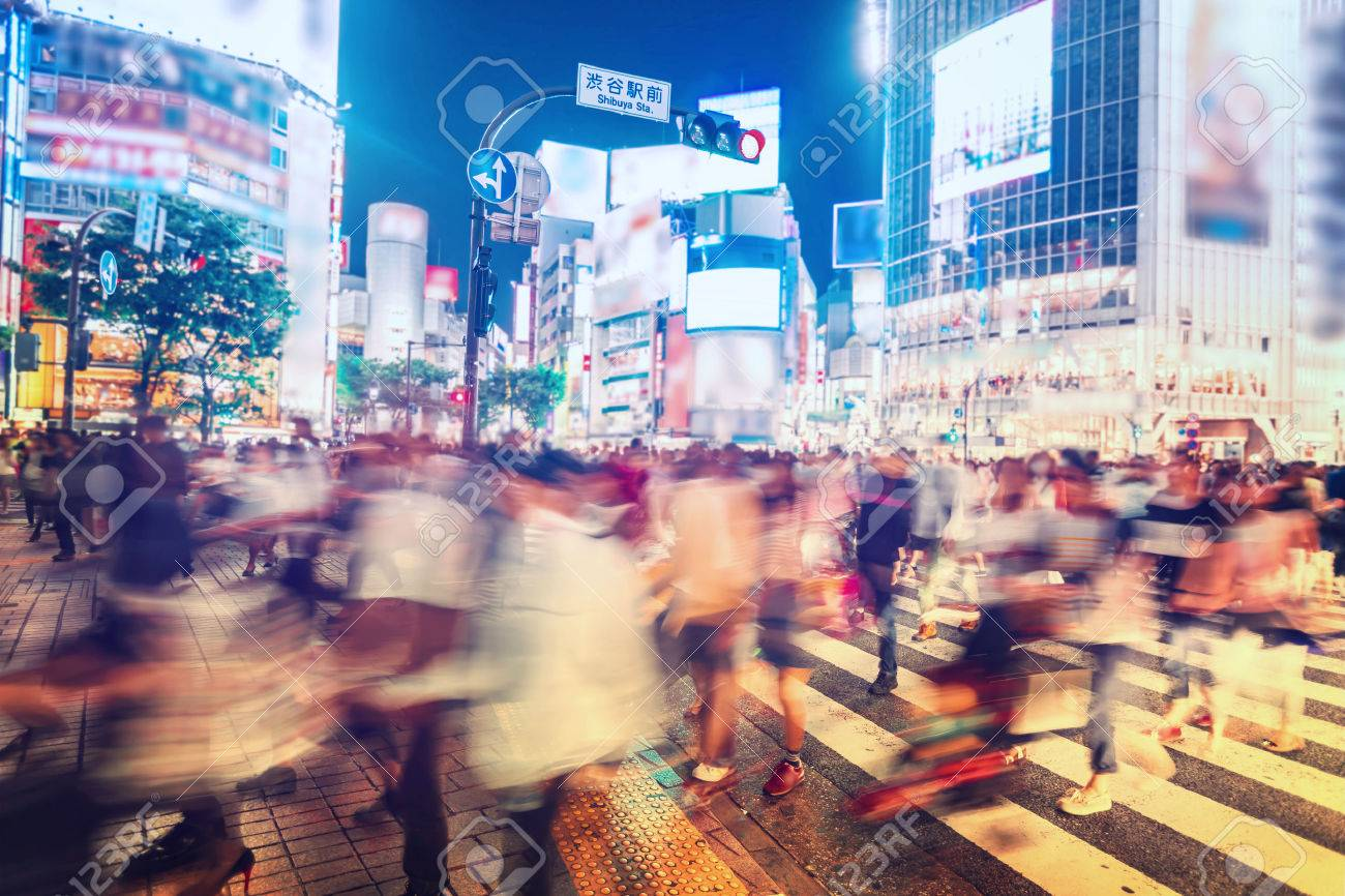 People and vehicles cross the famously busy Shibuya station intersection in Tokyo - 30723143