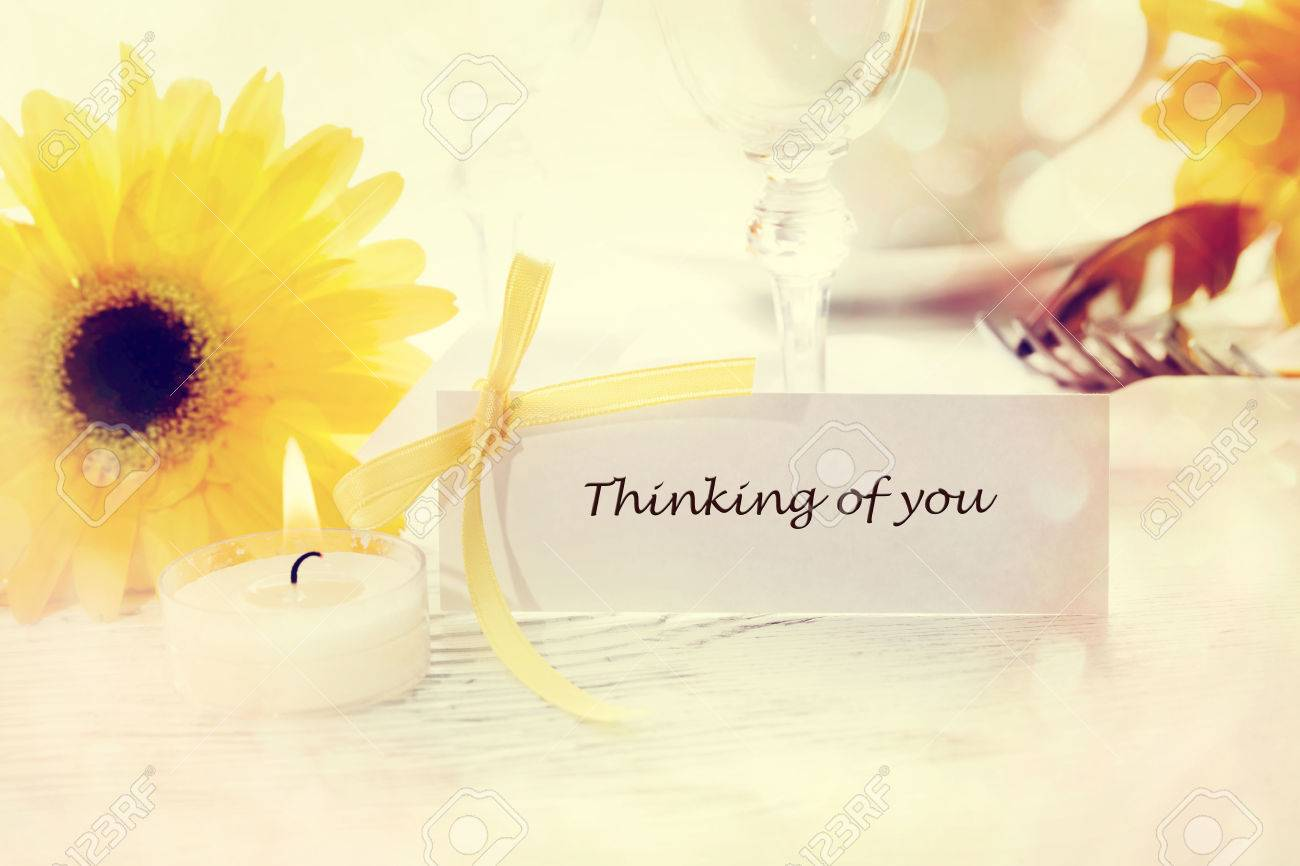 thinking of you message card with table setting and yellow gerberas