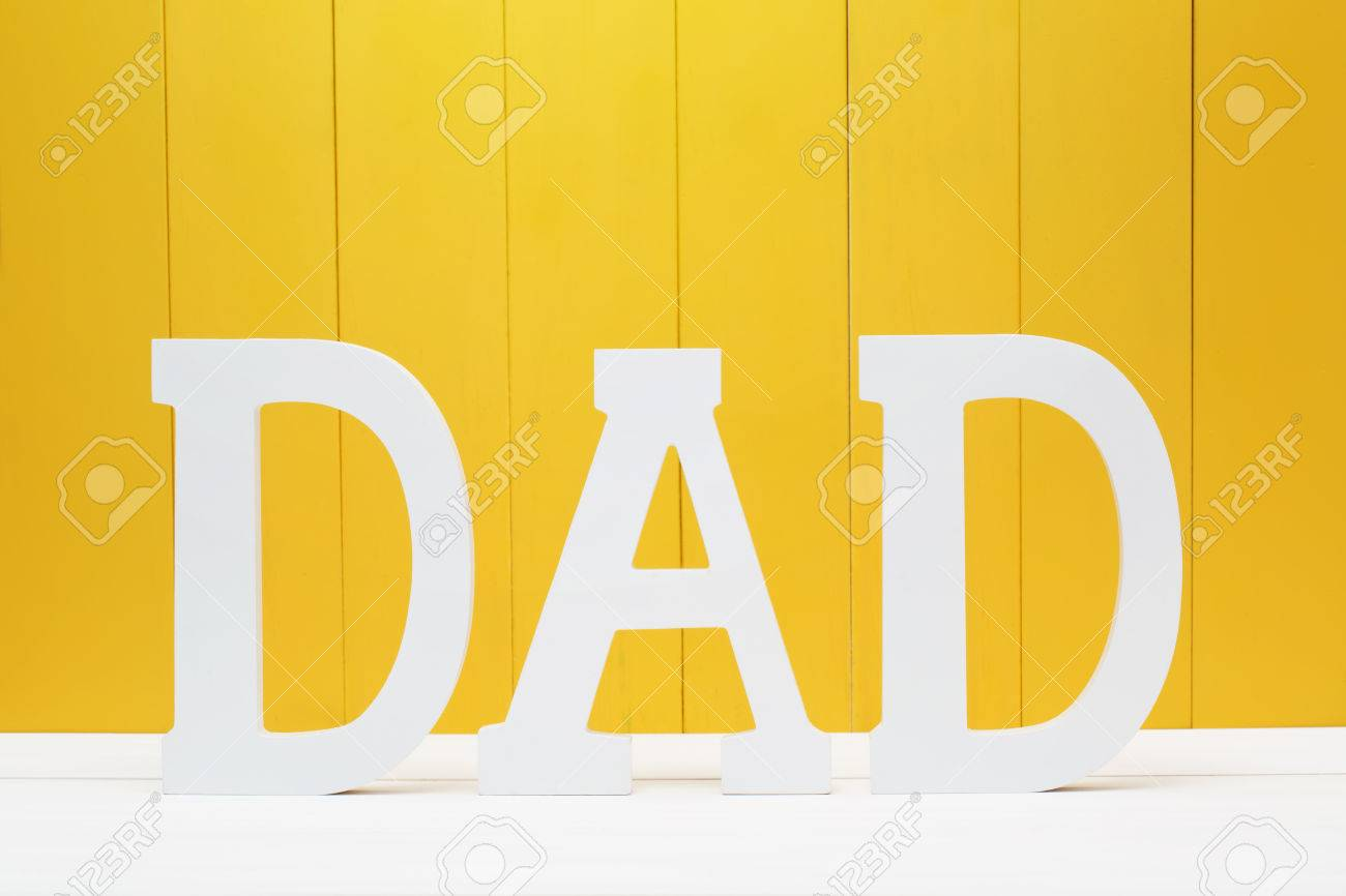 DAD Text Letters On Yellow Wooden Wall Background Stock Photo ...