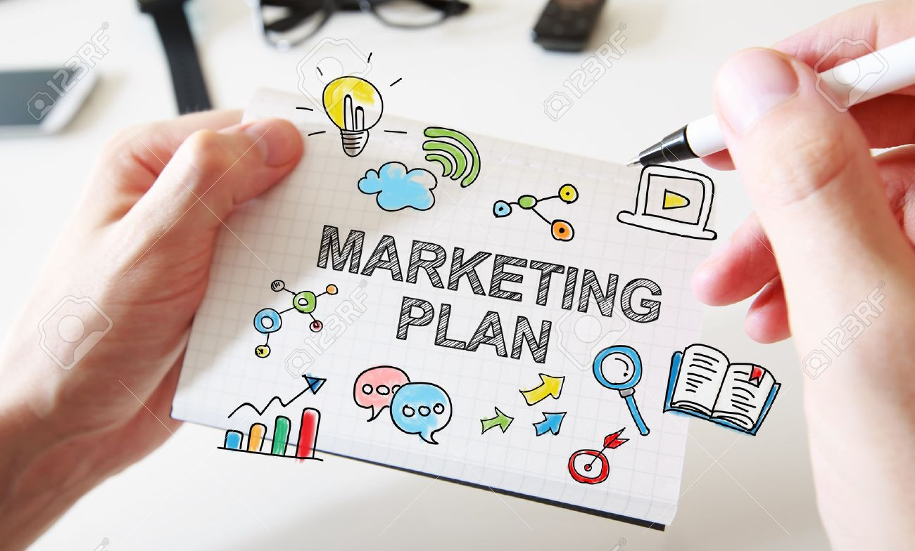 Mans hand drawing Marketing Plan concept on white notebook Stock Photo - 46051203