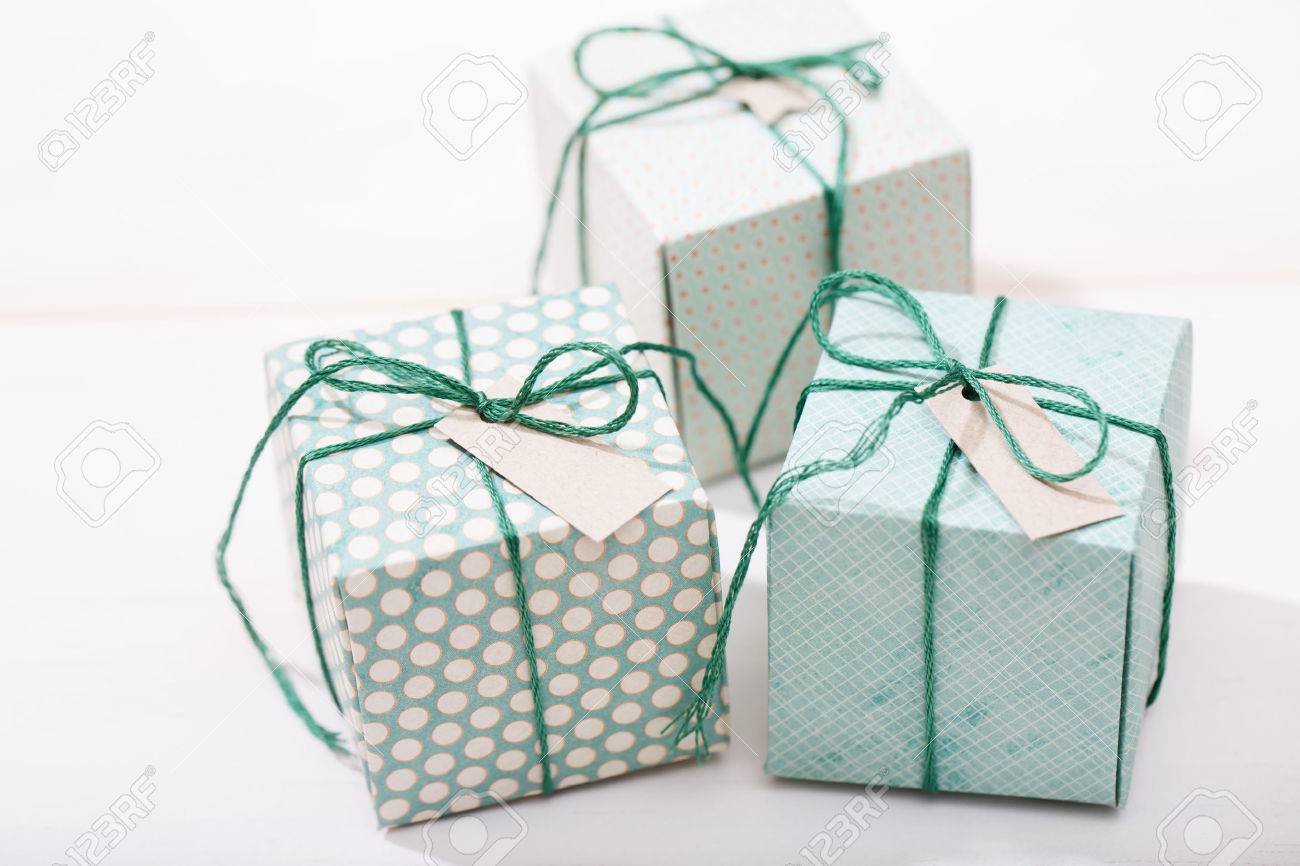 Handmade Small Green Gift Boxes On White Wooden Table