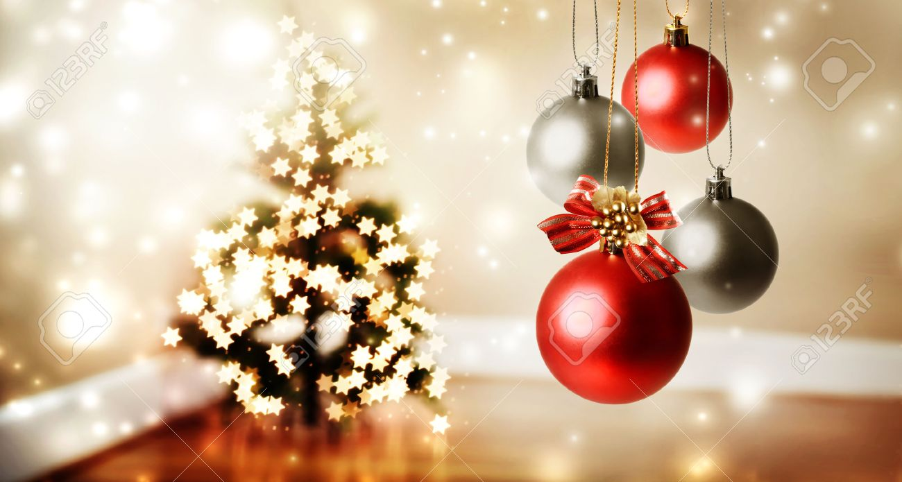 Christmas Baubles With Star Shaped Lights On A Christmas Tree Stock Photo    47808091