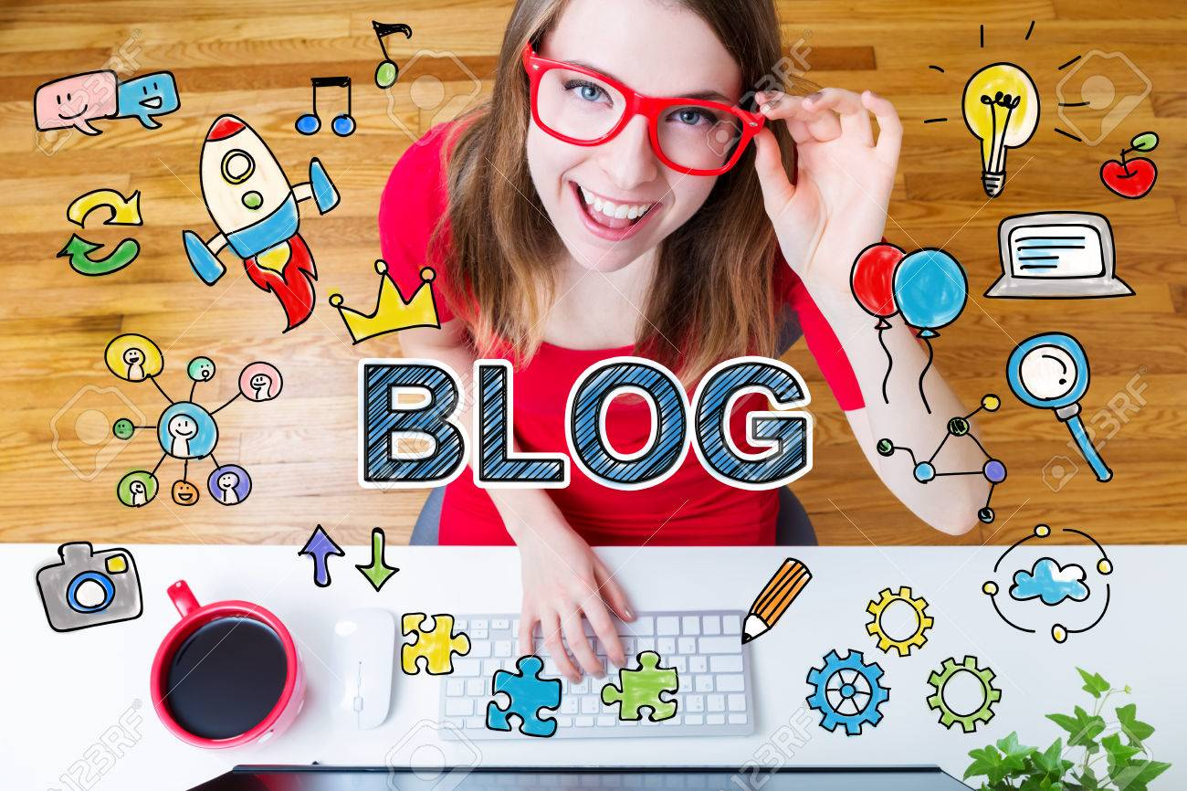 Blog concept with young woman wearing red glasses in her home office - 52412056