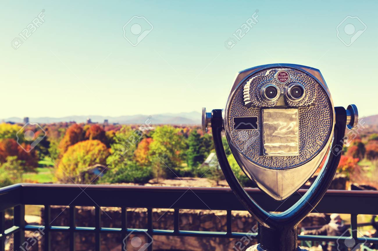 Coin-operated binoculars looking out over an autumn landscape - 53023287