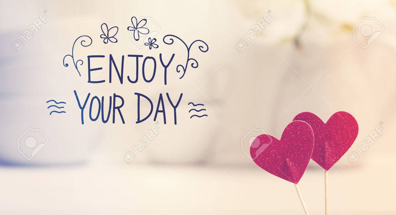 Enjoy You Day Message With Small Red Hearts With White Dishes Stock Photo    53024183