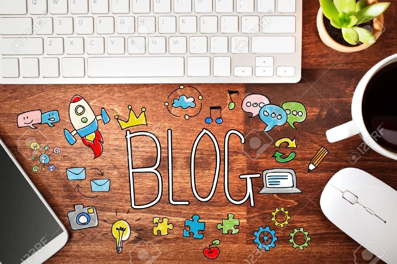 Blog concept with workstation on a wooden desk - 53676576