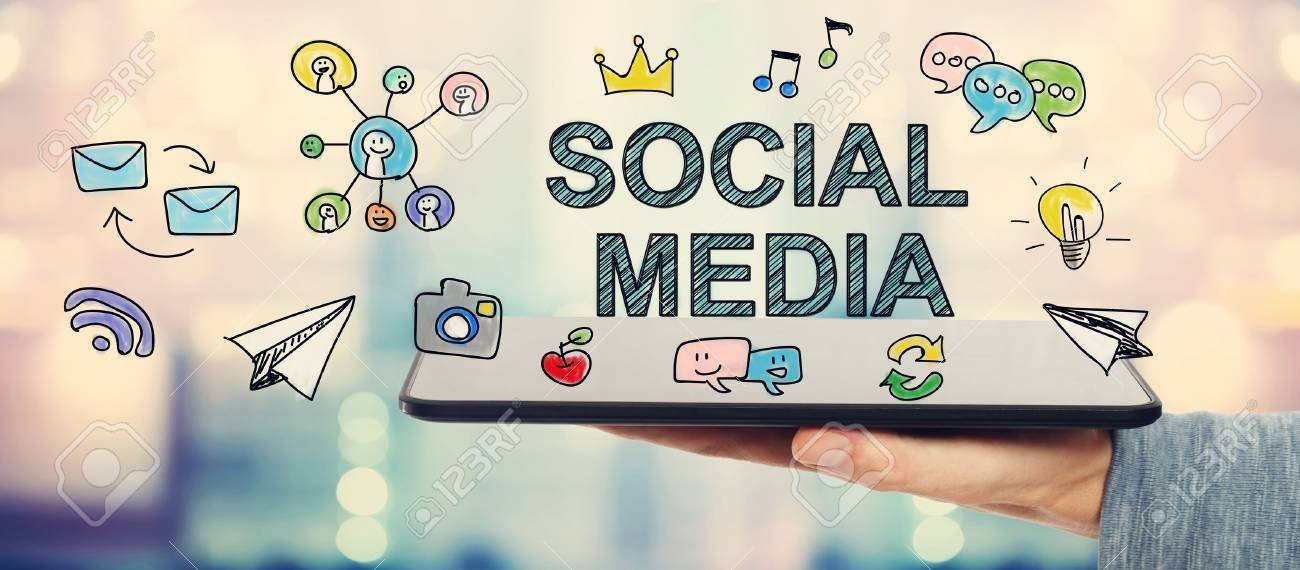 Social Media concept with man holding a tablet computer - 53678394