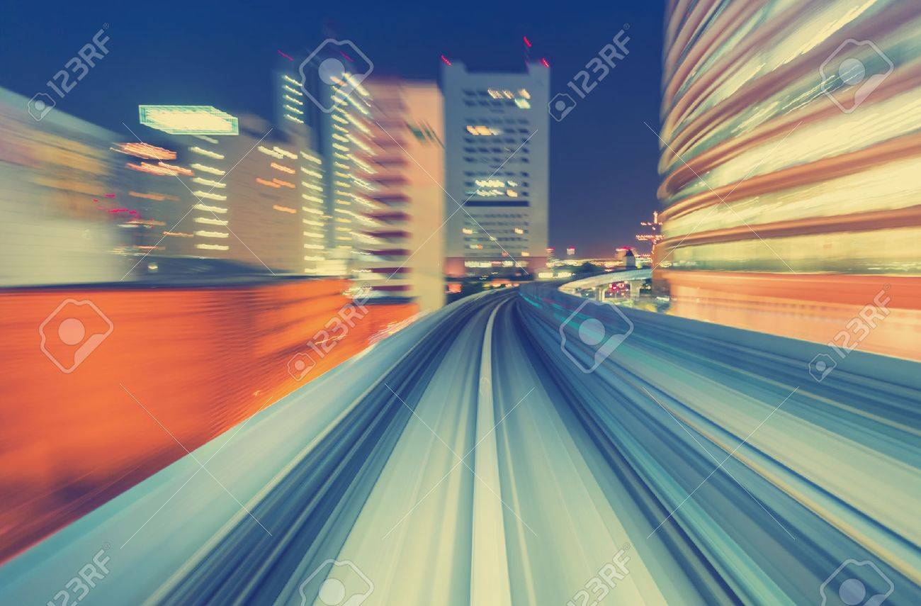 Abstract high speed technology POV motion blurred concept image from the Yuikamome monorail in Tokyo Japan - 54119915