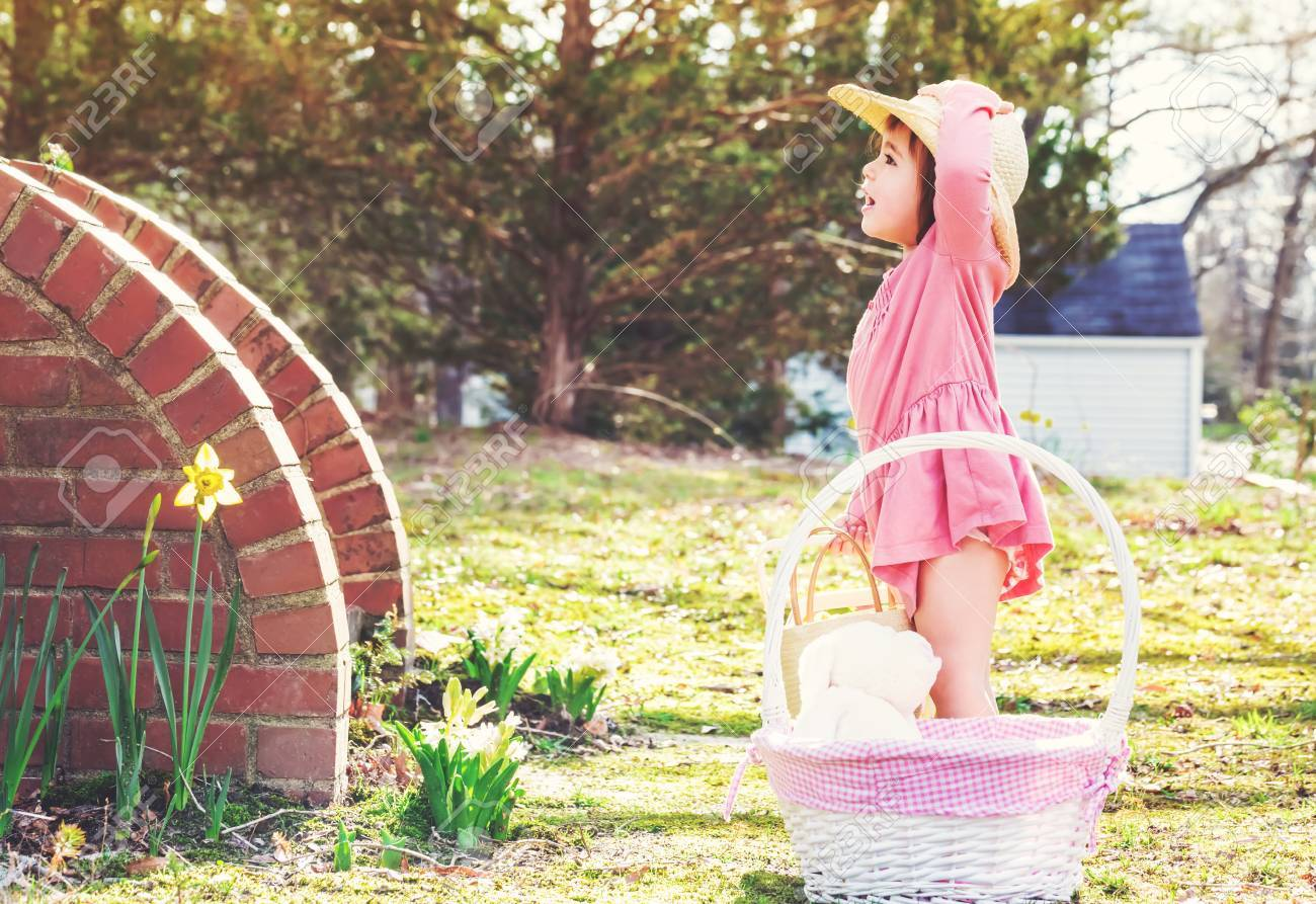 Happy toddler girl playing outside with an easter basket stock photo happy toddler girl playing outside with an easter basket stock photo 54659991 negle Gallery