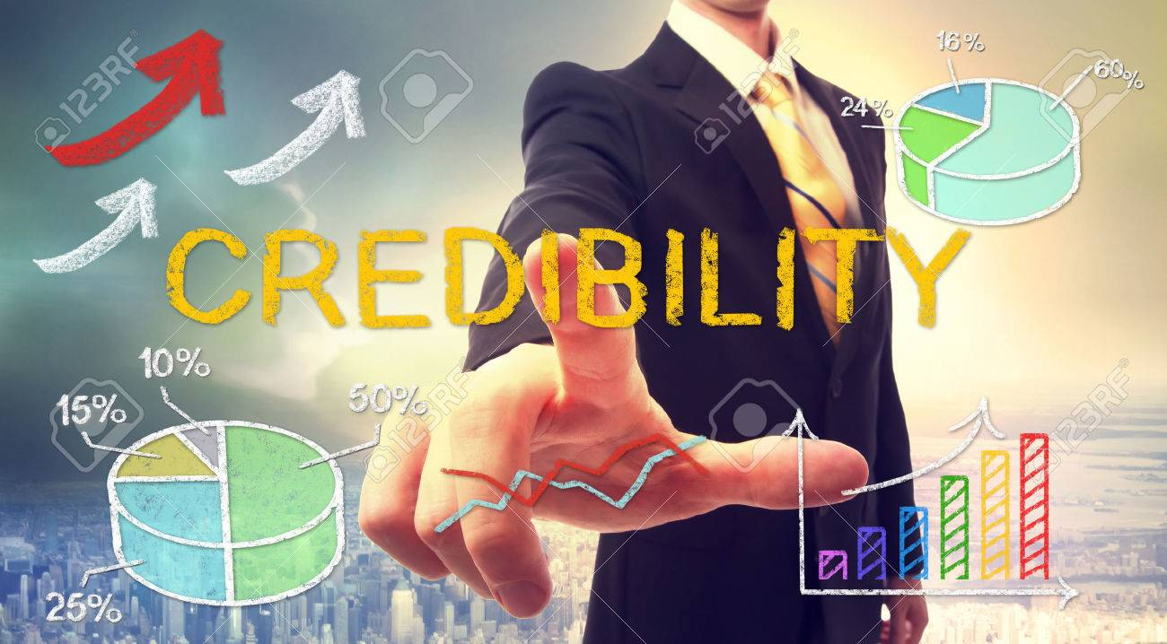 Credibility concept with businessman and graphs and arrows Standard-Bild - 54662719