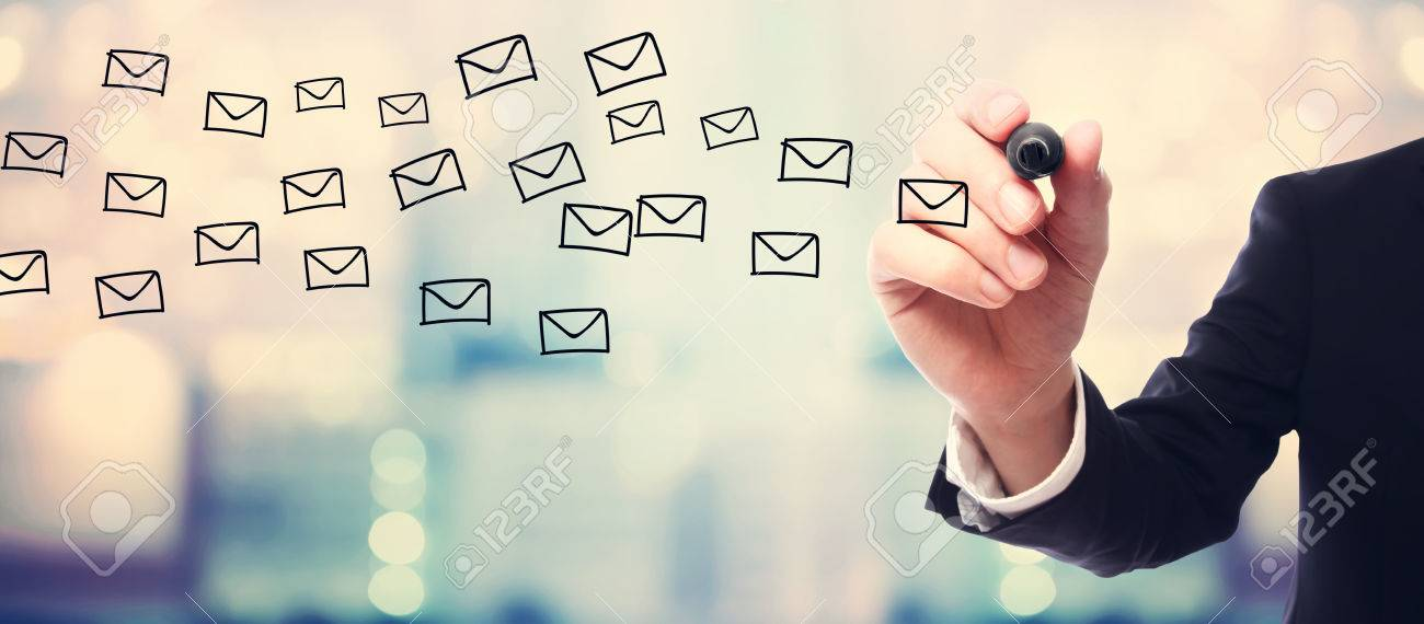 Businessman drawing E-mails concept on blurred abstract background Standard-Bild - 55970898