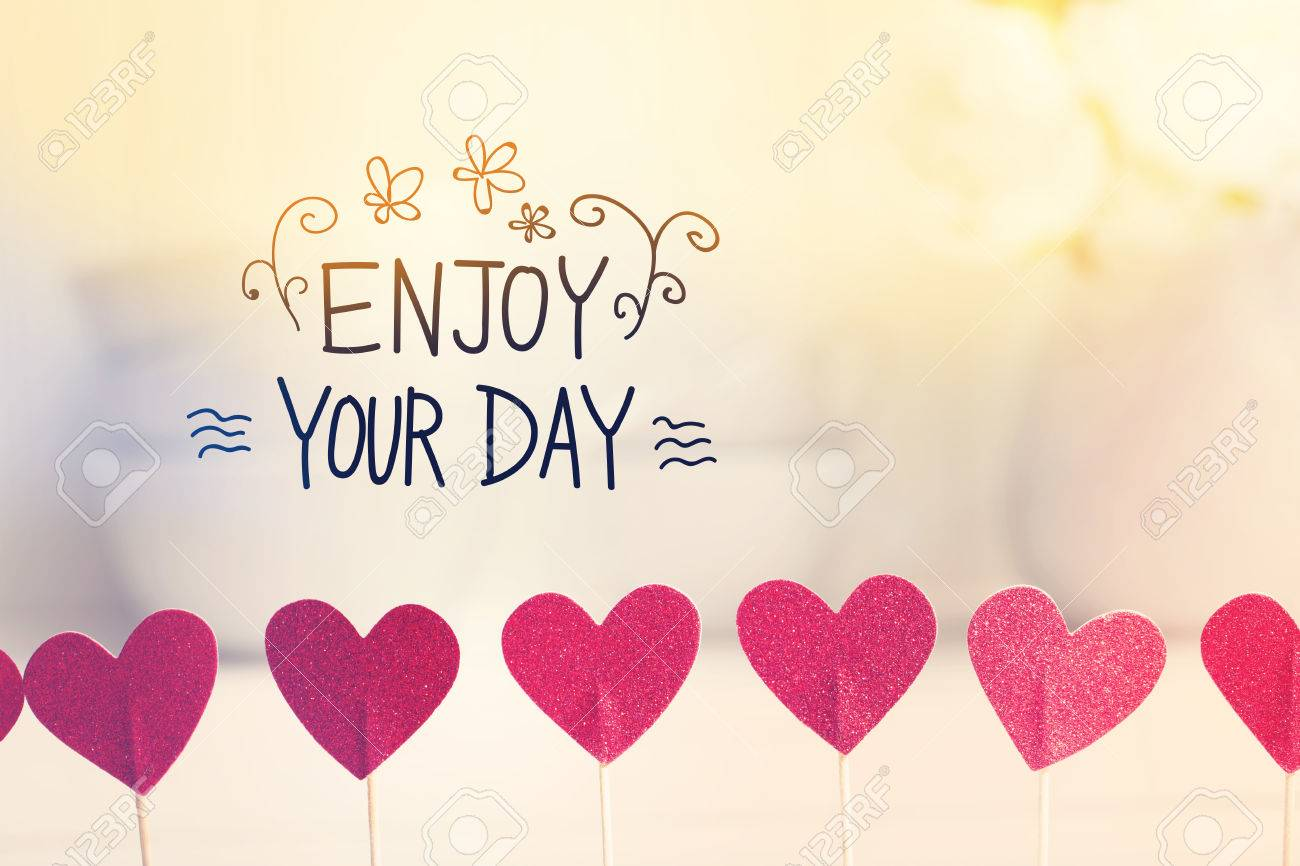 Wonderful Enjoy Your Day Message With Small Red Hearts With White Dishes Stock Photo    55970691
