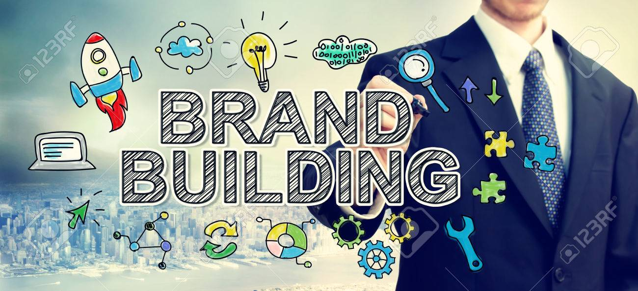 Businessman drawing Brand Building concept above the city Standard-Bild - 56468313
