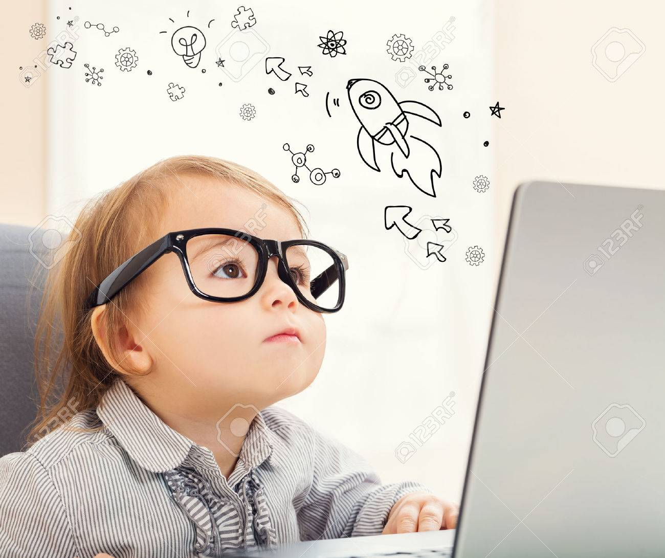 Rocket and Gears concept with toddler girl using her laptop - 56468413