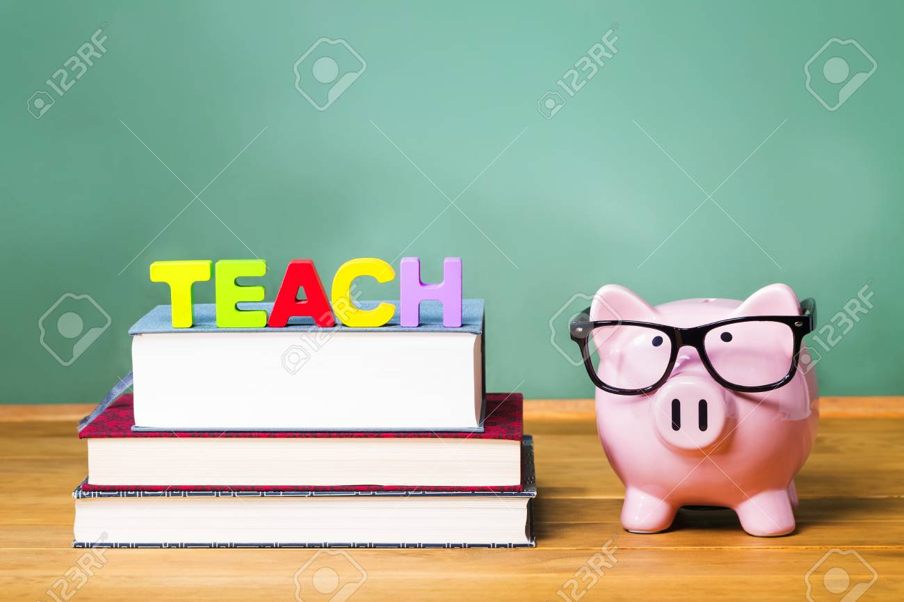 Teaching Theme With Pink Piggy On Top Of Books With Chalkboard