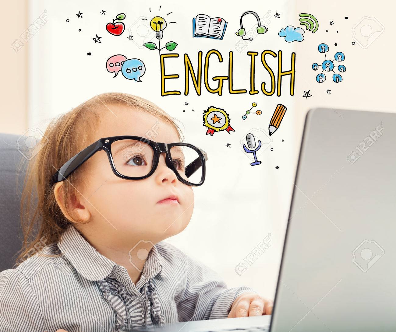 English concept with toddler girl using her laptop Standard-Bild - 59198850