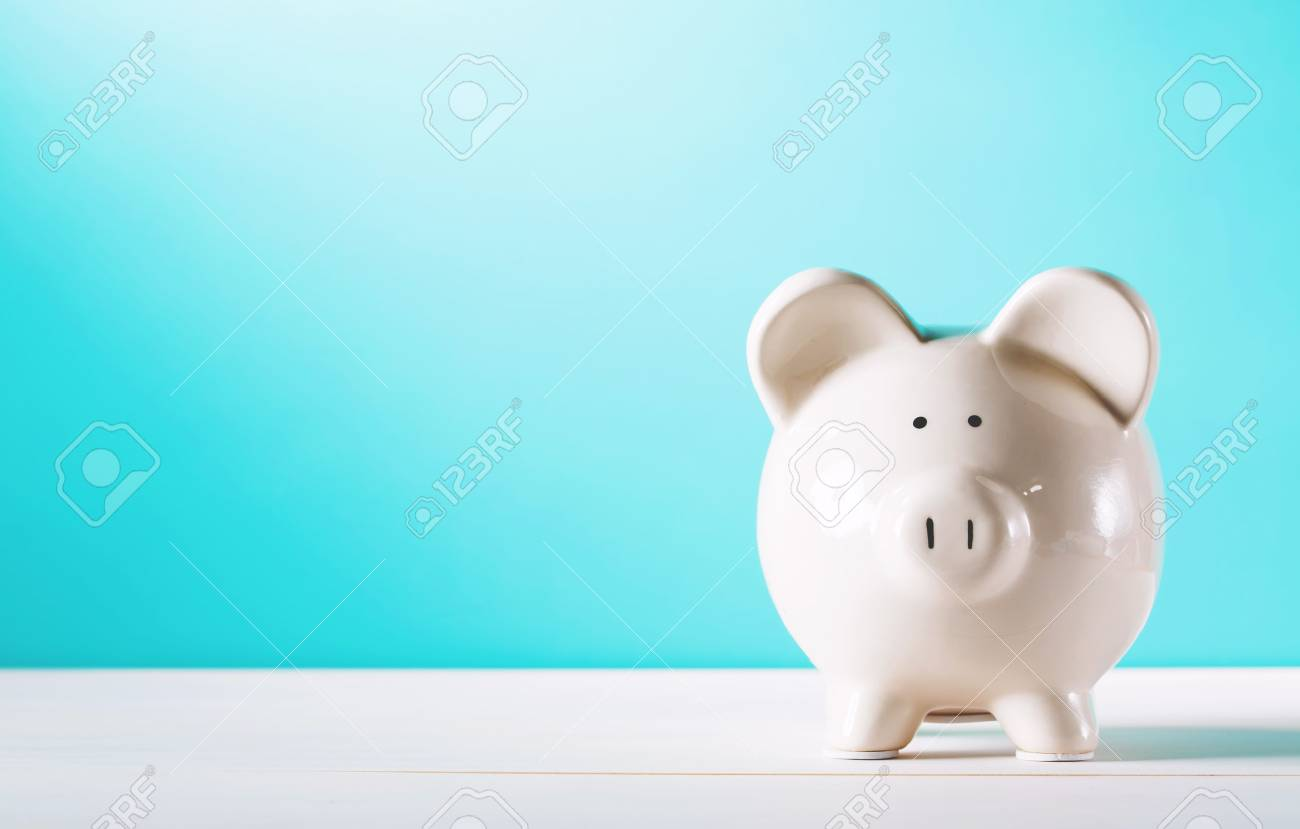 White piggy bank isolated on blue background - 60941796