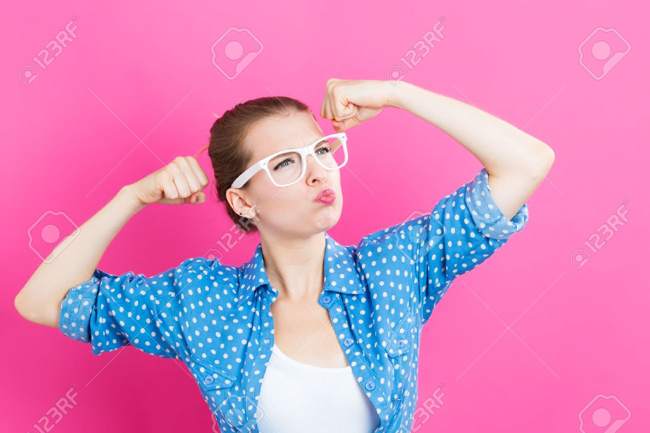 Powerful young woman on a pink background Standard-Bild - 62155817