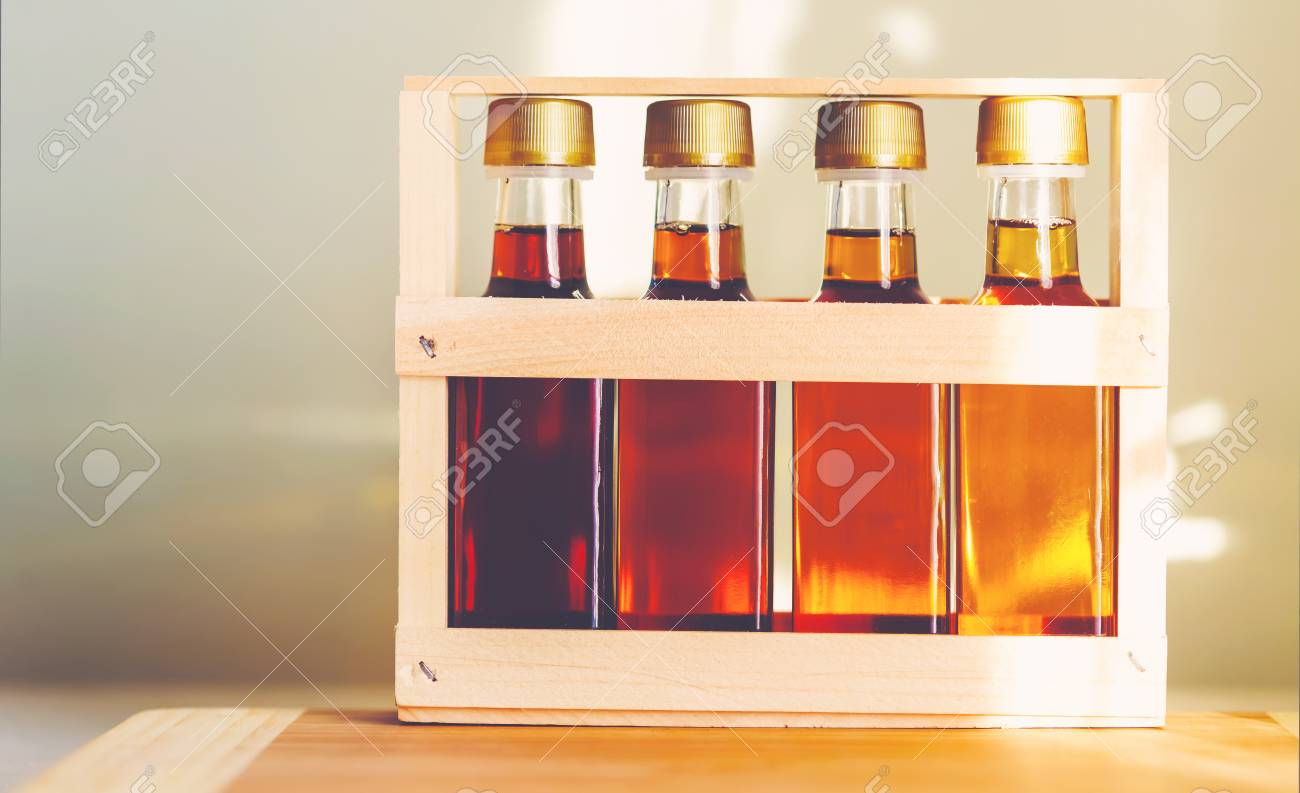 3a758d9c0c5 Four grades of of maple syrup in glass bottles in sunlight Stock Photo -  64891133