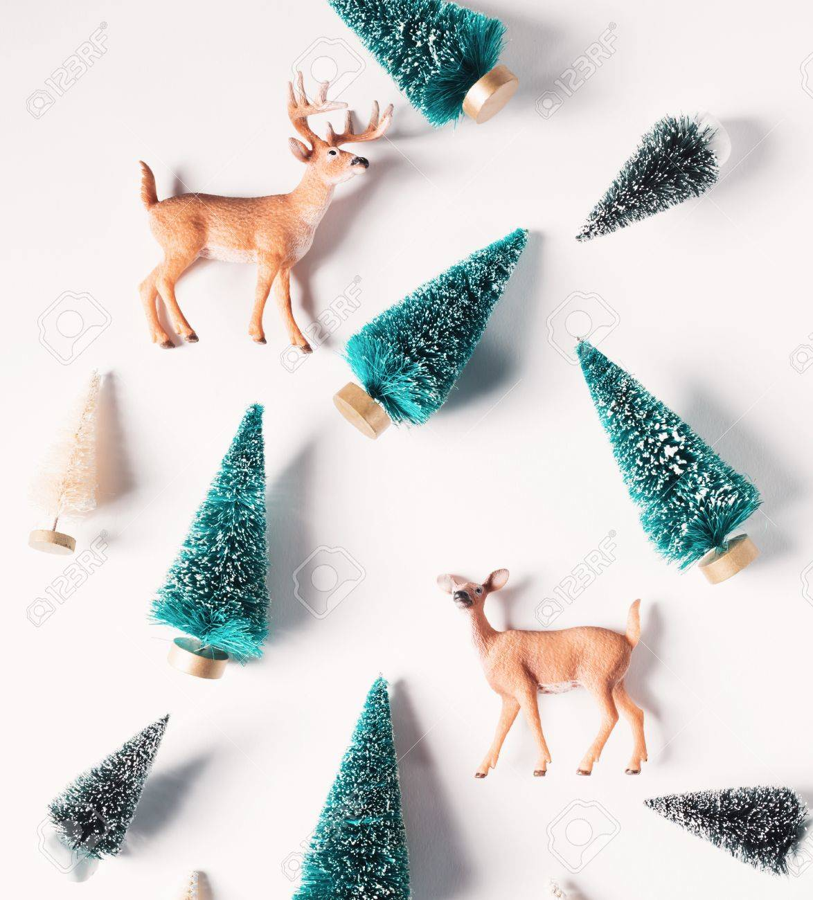 Christmas trees and deer from top view Standard-Bild - 64676630