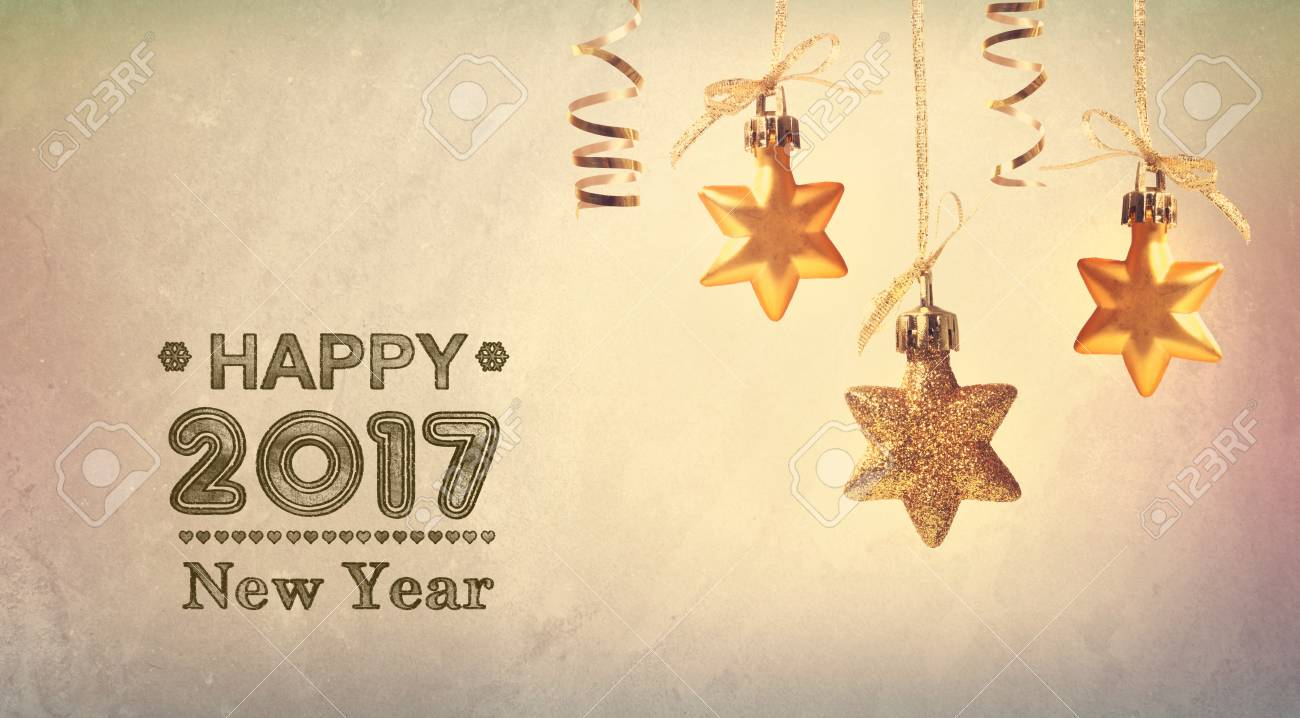 happy new year 2017 message with hanging star ornaments stock photo