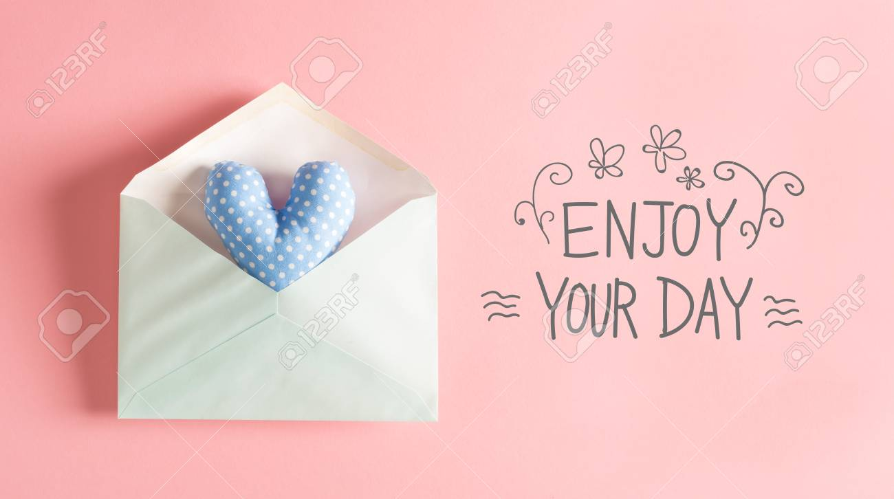 Enjoy Your Day Message With A Blue Heart Cushion In An Envelope Stock Photo    80956218