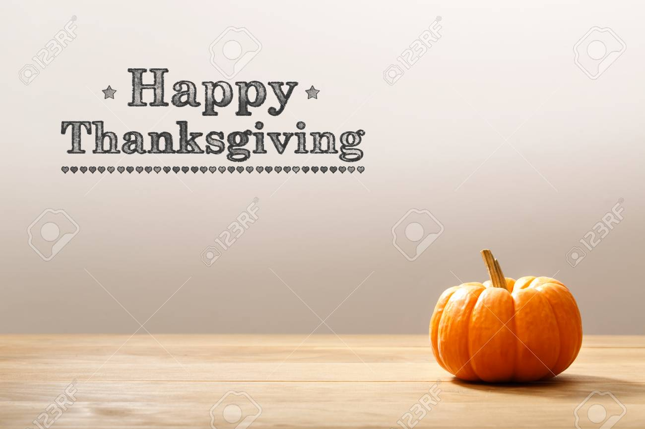 Thanksgiving message with a orange small pumpkin - 88118937