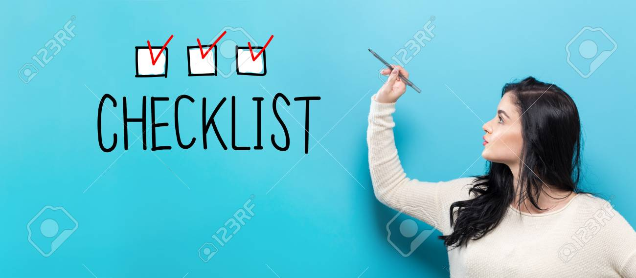 Checklist with young woman holding a pen on a blue background - 95902074