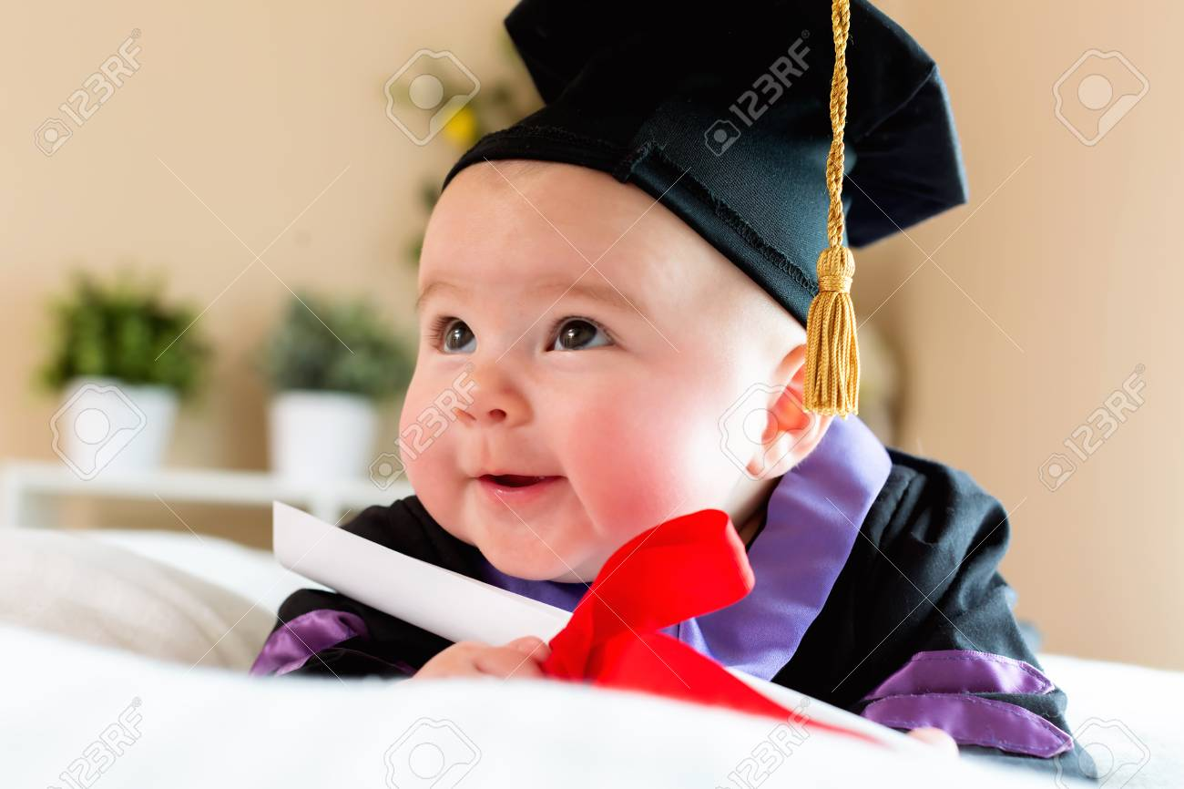 Little Baby Girl In Graduation Cap And Gown Stock Photo, Picture And ...