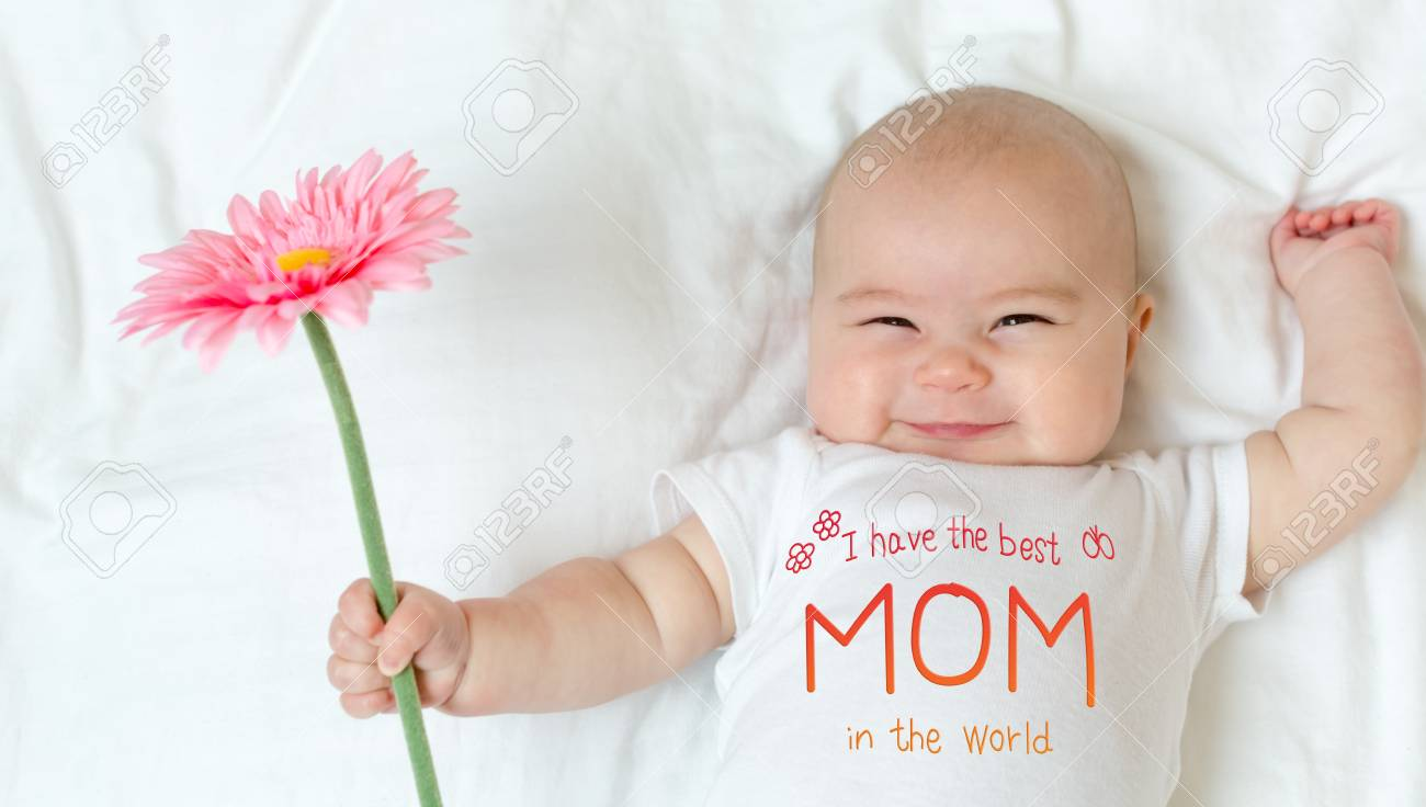 Mothers Day message with baby girl holding a flower - 98320933
