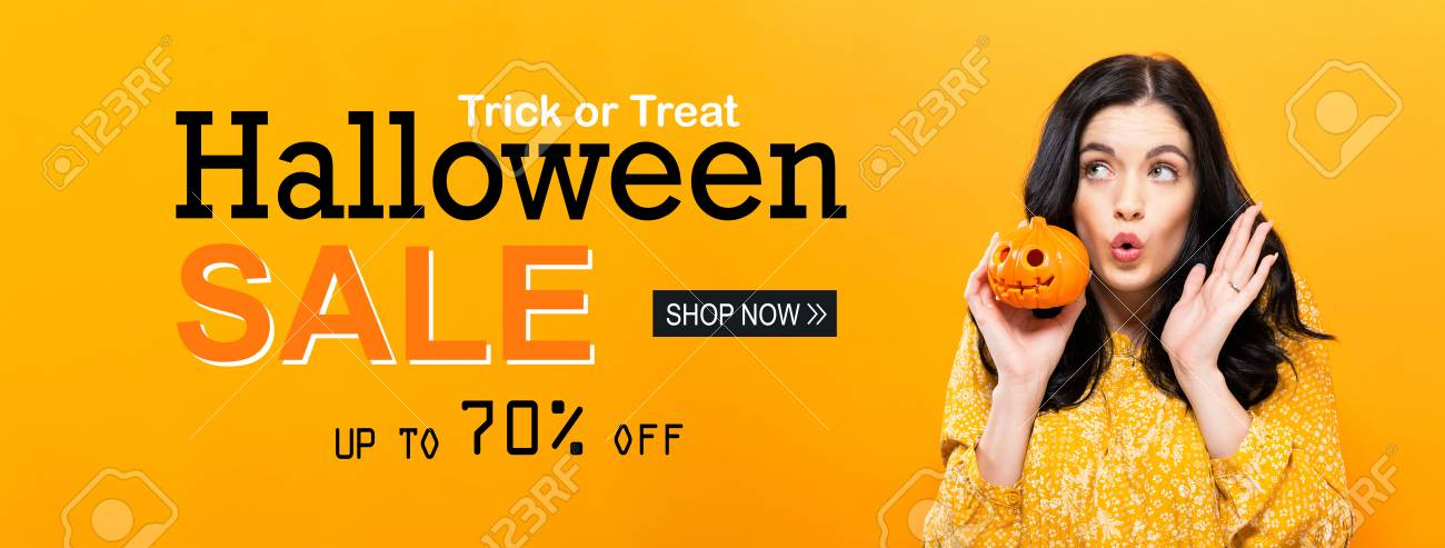 Halloween sale with young woman holding a pumpkin - 108461459
