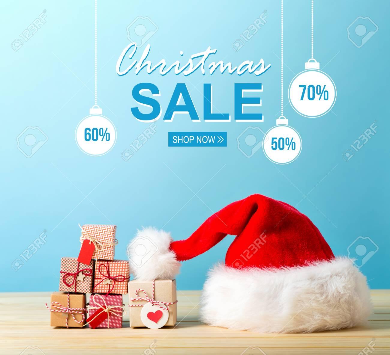 Christmas Sale Message With A Santa Hat And Tiny Christmas Gift ...