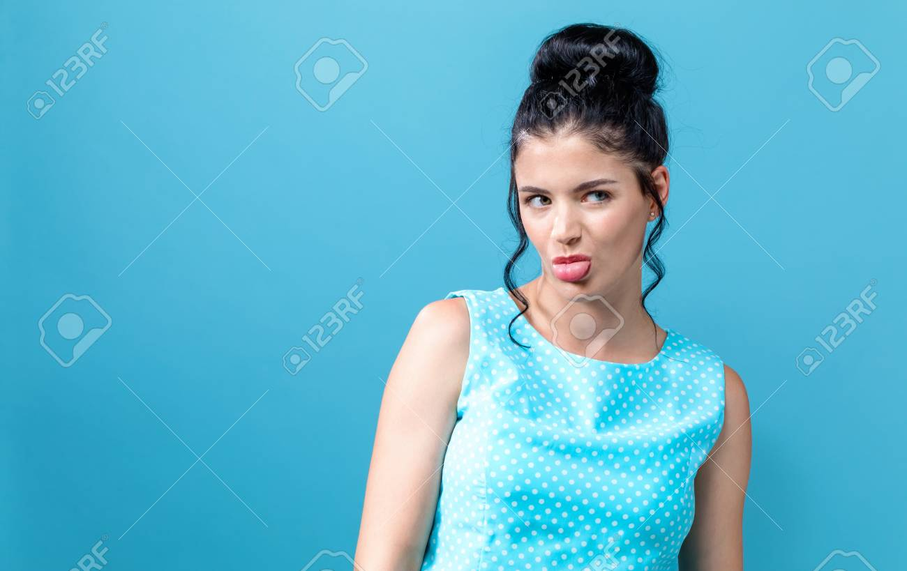 Disgusted face expression with young woman on a solid background - 109802877