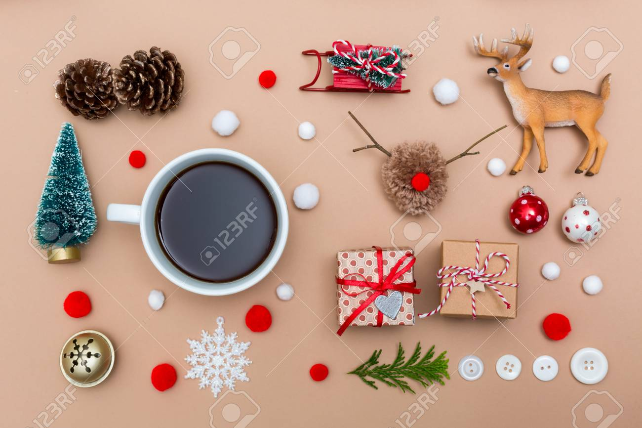 Coffee Christmas Ornaments.Christmas Ornaments With Coffee Cup On A Light Brown Paper Background
