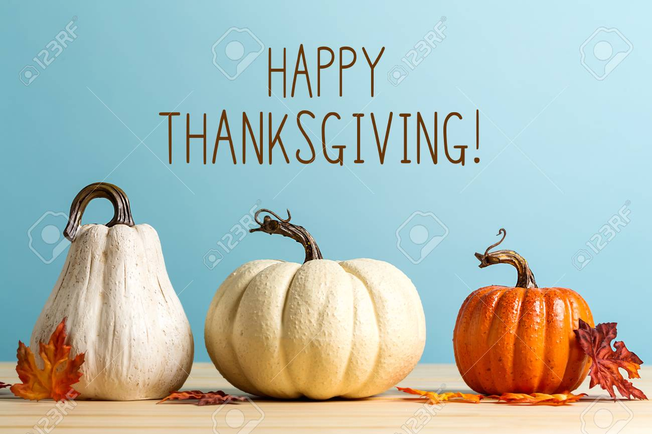 Thanksgiving message with pumpkins on a blue background - 111828996