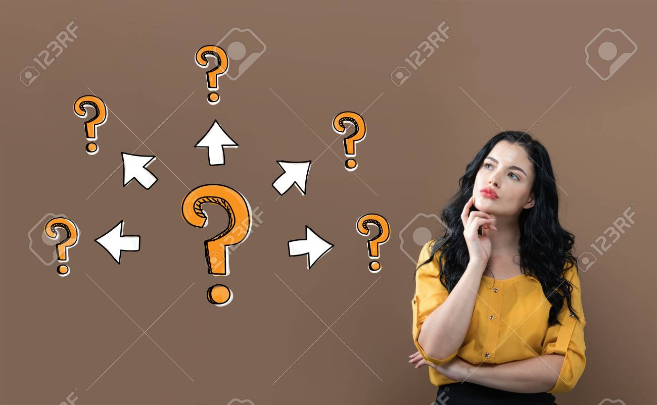 Big and small question marks with arrows with young businesswoman on a brown background - 114974060