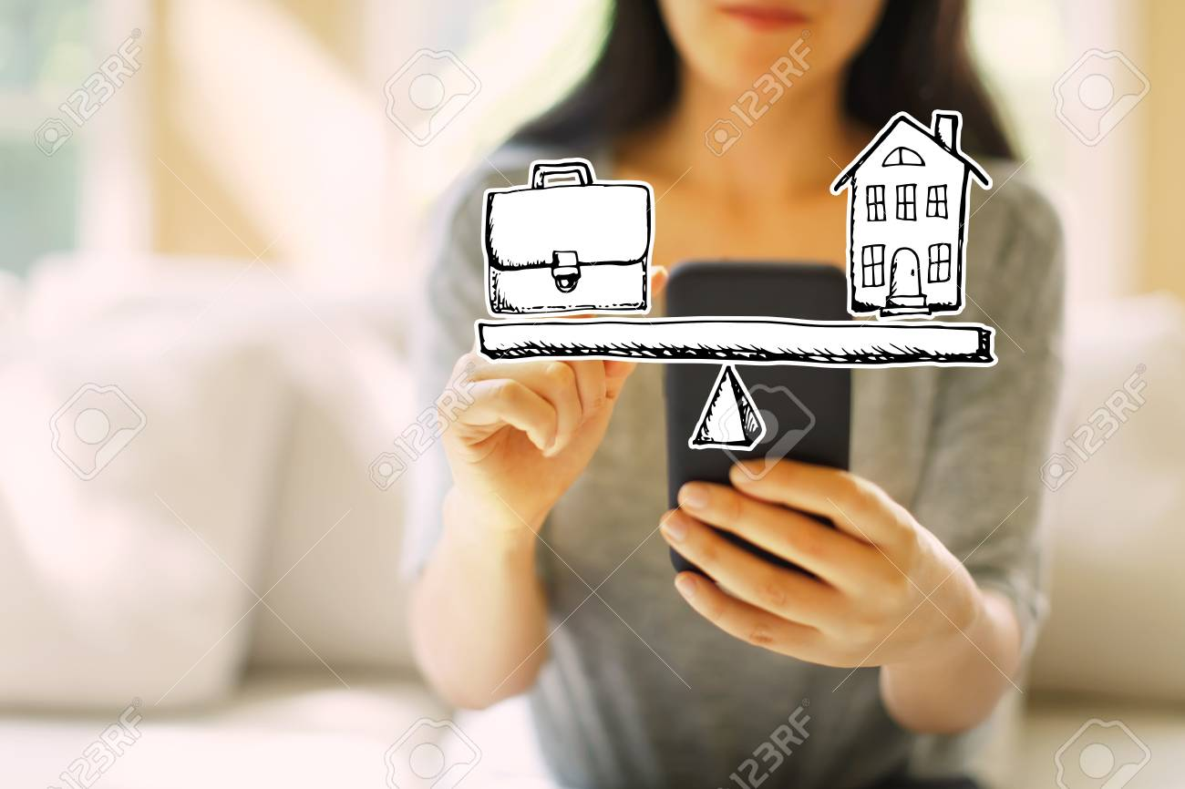 Work and life balance with woman using her smartphone in a living room - 116956621