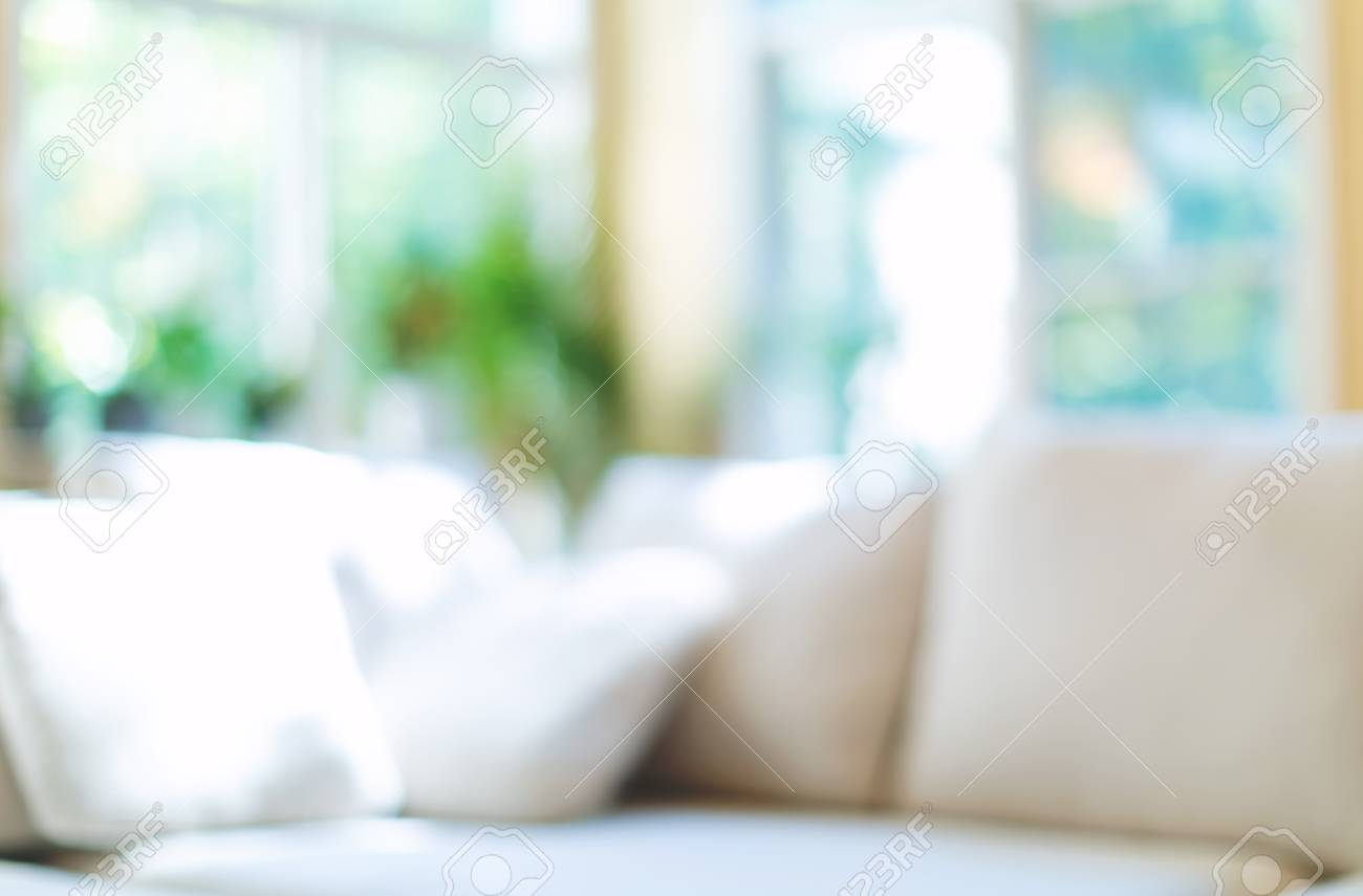 Blurred home interior background with couch and natural light - 120343621