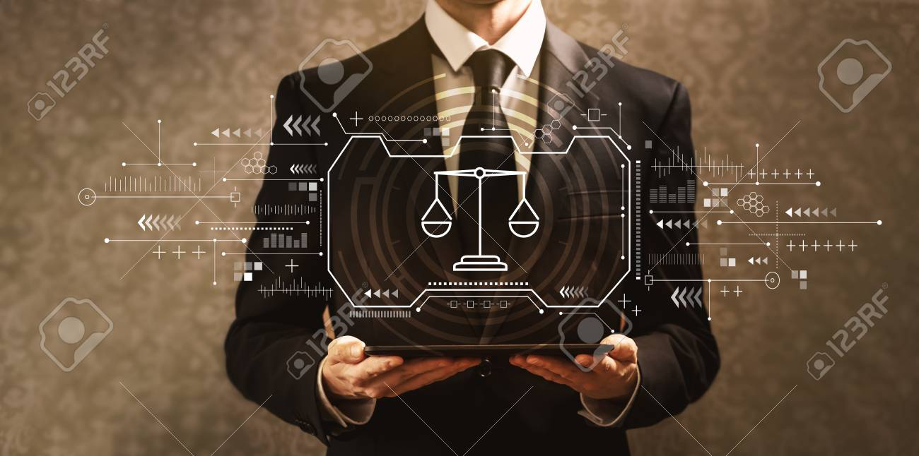 Justice theme with businessman holding a tablet computer - 121025417