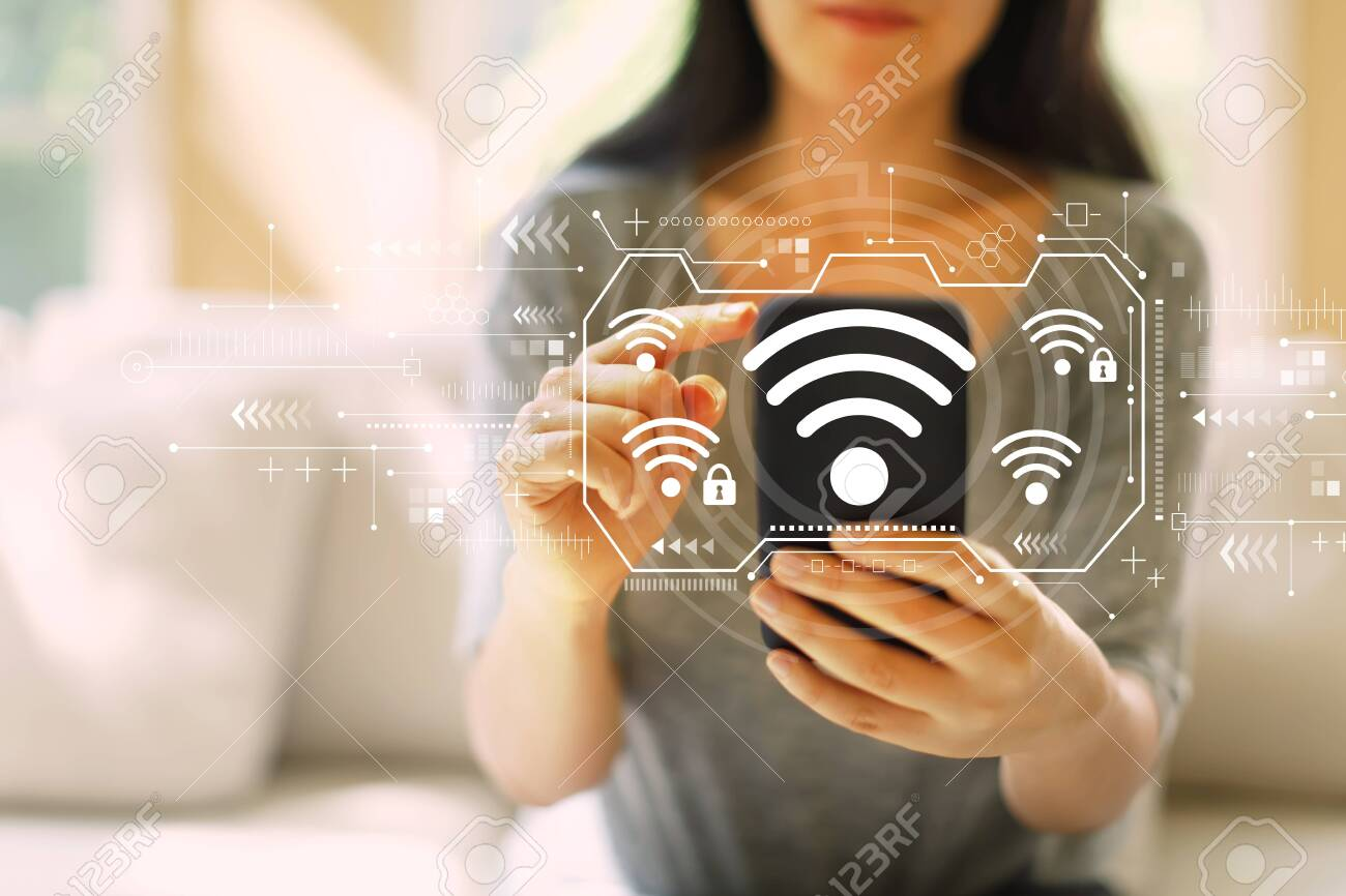 Wifi with woman using her smartphone in a living room - 122208613