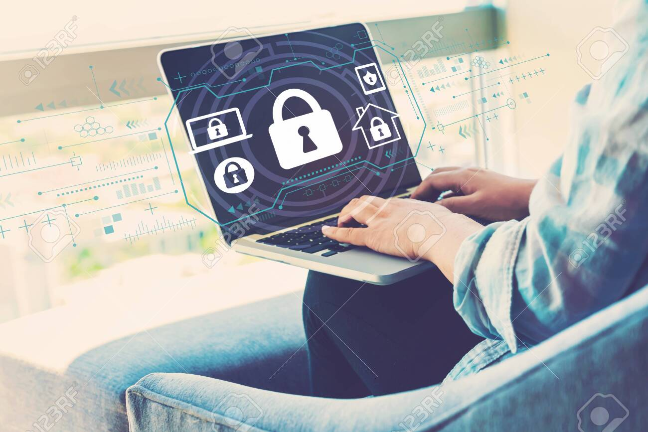 Security theme with woman using her laptop in her home office - 123497527