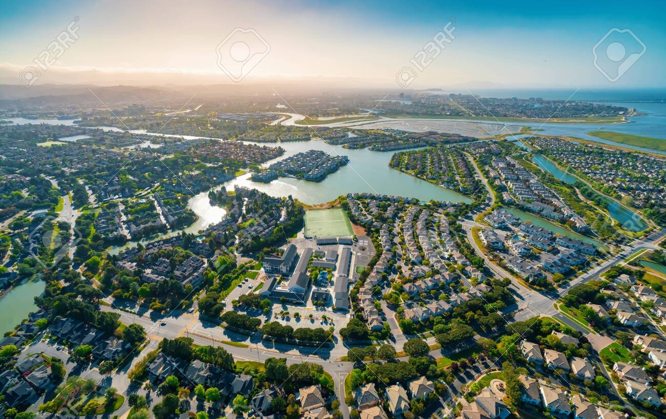 Aerial view of residential real estate homes in Foster City, CA - 124589907