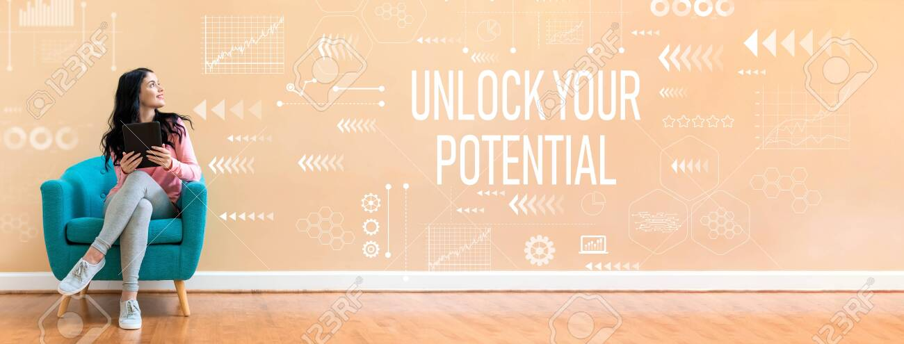 Unlock your potential with young woman holding a tablet computer in a chair - 125954300