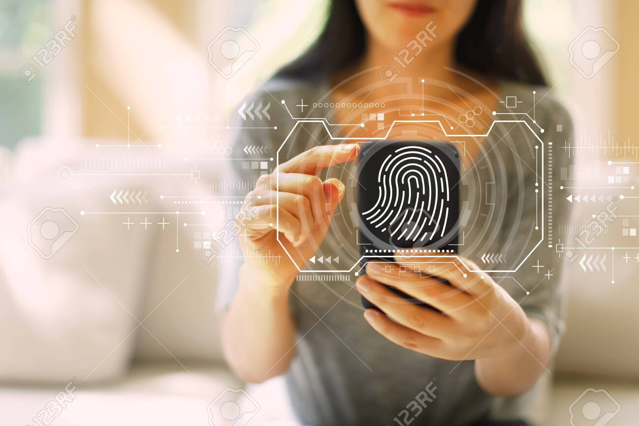 Fingerprint scanning theme with woman using her smartphone in a living room - 126427076
