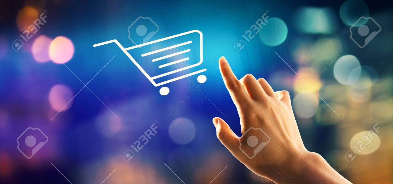 Online shopping theme with hand pressing a button on a technology screen - 127841146