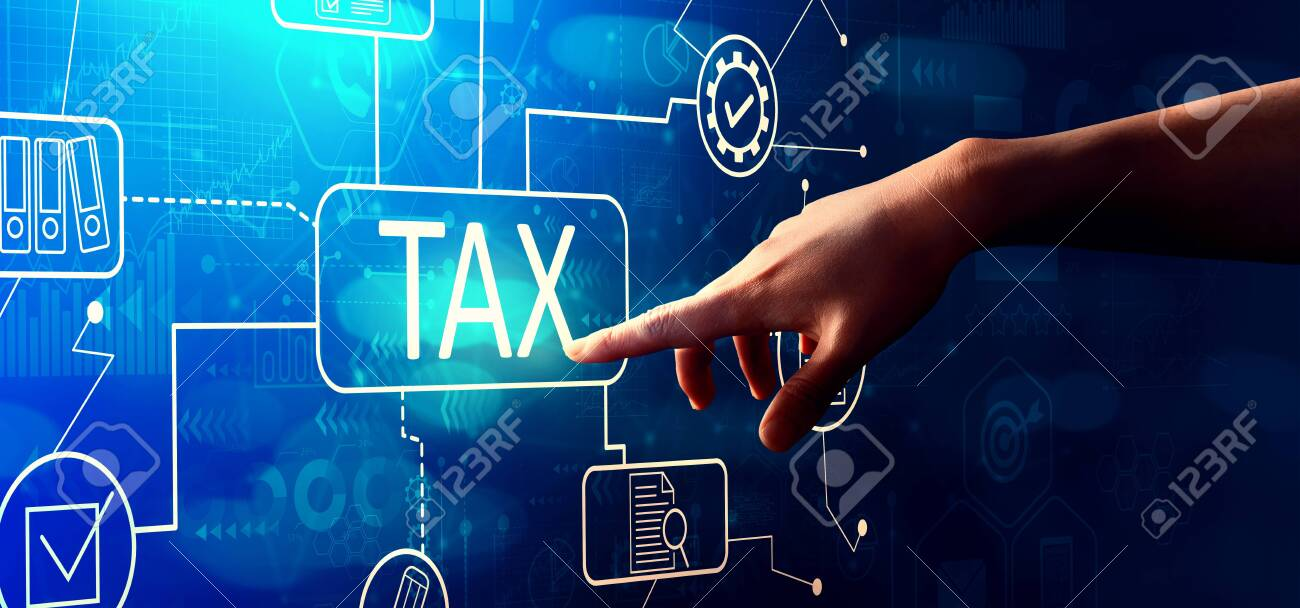 Tax theme with hand pressing a button on a technology screen - 129938460