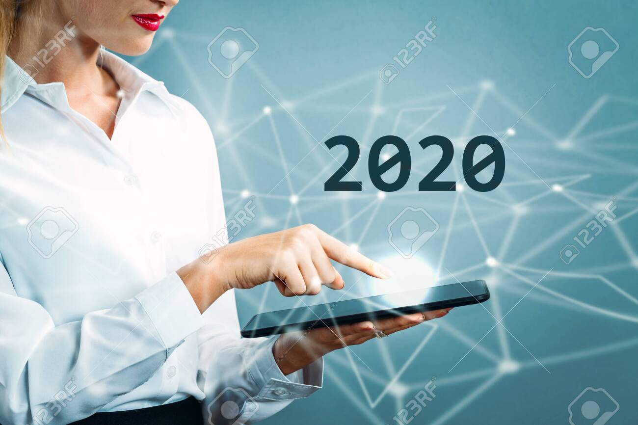 2020 text with business woman using a tablet - 132178028